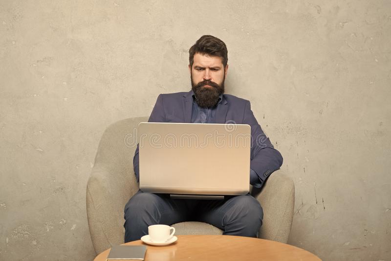 Businessman work laptop. Man drink coffee in business office. Responding business email. Digital marketing. Surfing royalty free stock images