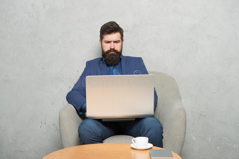Businessman work laptop. Man drink coffee in business office. Responding business email. Digital marketing. Surfing. Internet. Buy online. Project manager royalty free stock photos