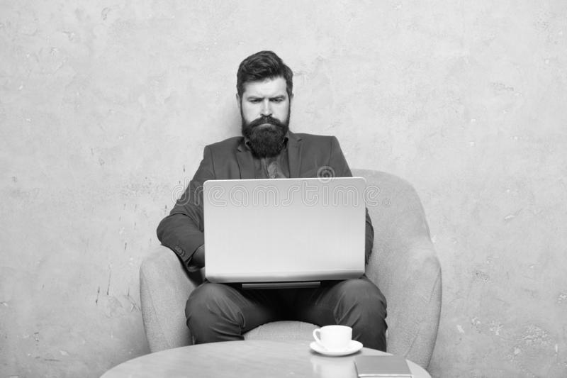 Businessman work laptop. Man drink coffee in business office. Responding business email. Digital marketing. Surfing. Internet. Buy online. Project manager royalty free stock photo