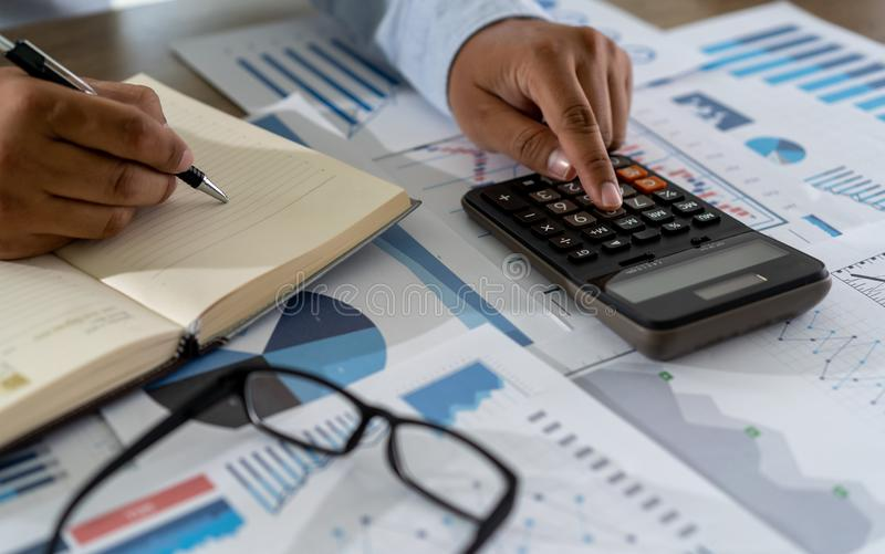 Businessman work math  finances and calculate cost invoice for budget to buy home stock images