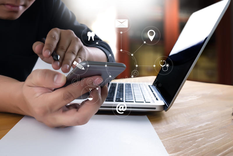 businessman work and working with smart phone and laptop and dig stock photos
