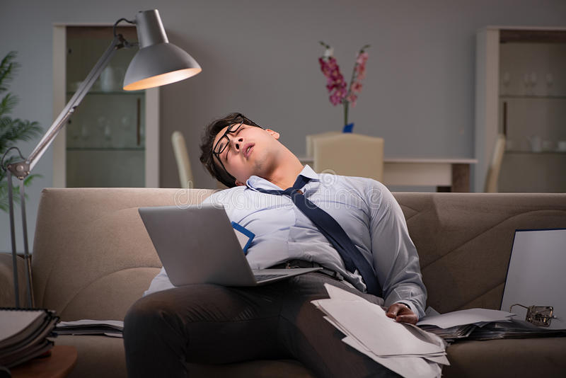 The businessman workaholic working late at home royalty free stock image
