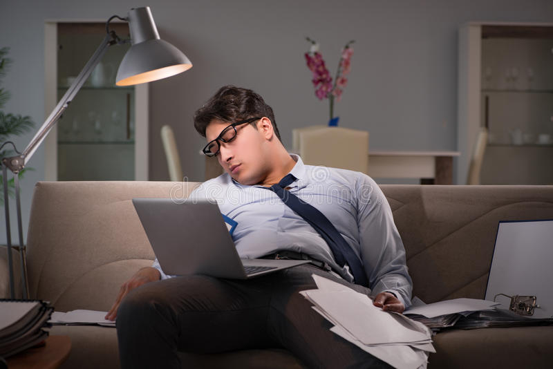 The businessman workaholic working late at home stock photo