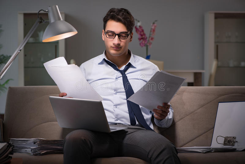 The businessman workaholic working late at home royalty free stock photos