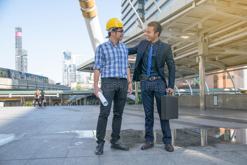 Download Businessman Worker Handshaking On Construction Site Stock Photo - Image: 83701083