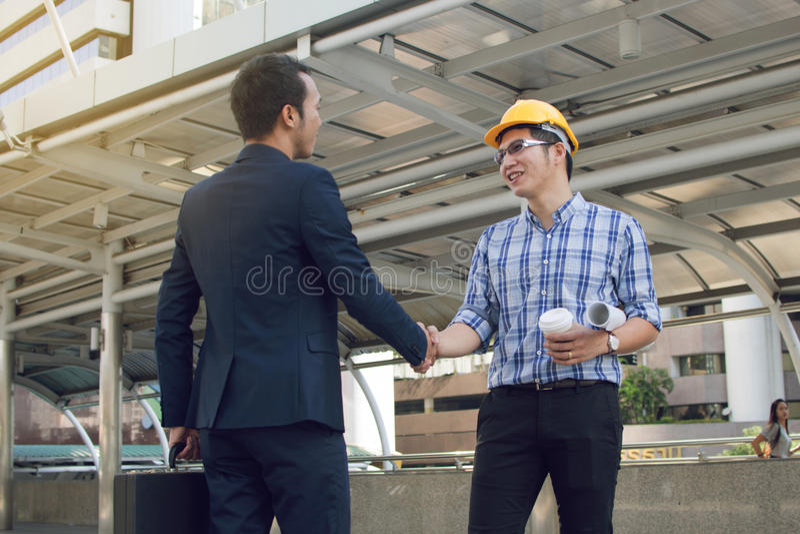 Download Businessman Worker Handshaking On Construction Site Stock Photo - Image: 83700556