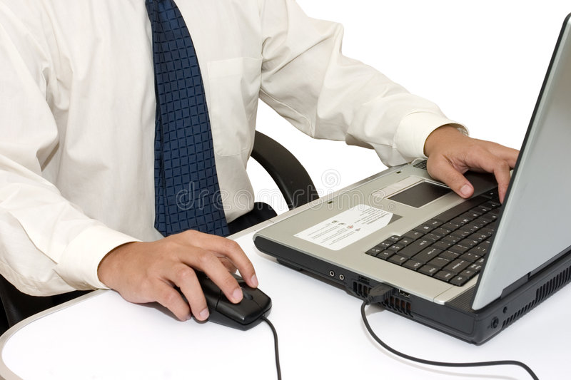 Businessman Working. Isolated Business man working with laptop royalty free stock photos