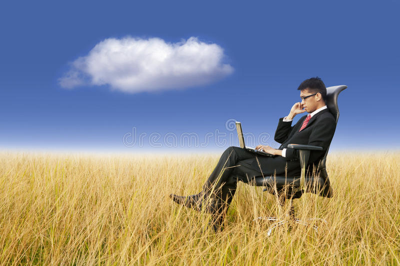 Businessman working anywhere with laptop. Cloud networking: businessman working with laptop stock photography
