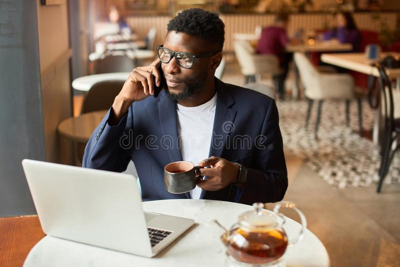 Businessman working from cafe stock photos