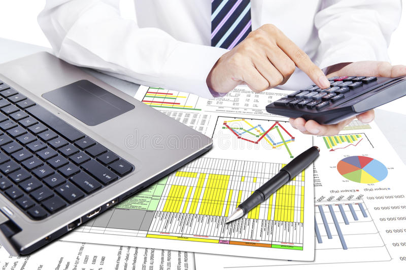 Businessman Working With Calculator Stock Photo