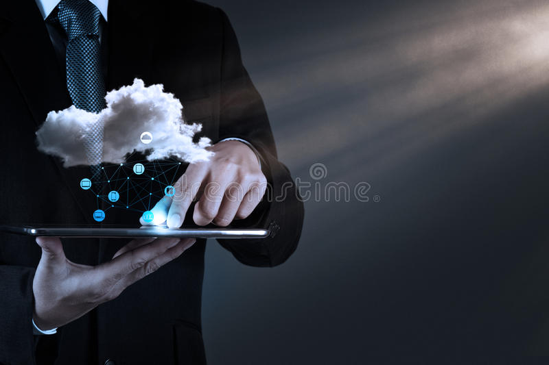 Businessman working with a Cloud Computing diagram on the new co. Businessman hand working with a Cloud Computing diagram on the new computer interface as royalty free stock photos