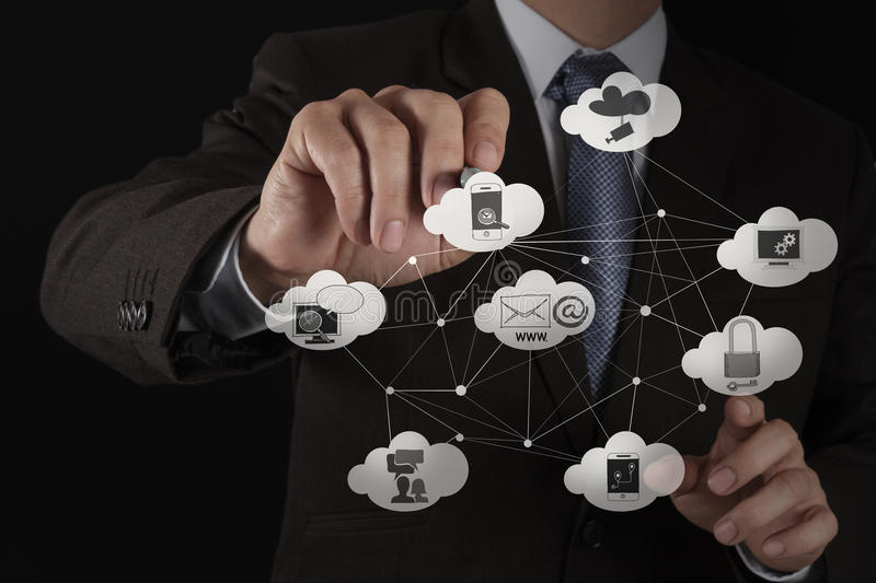 Businessman working with a Cloud Computing. Businessman hand working with a Cloud Computing diagram on the new computer interface as concept royalty free stock photo