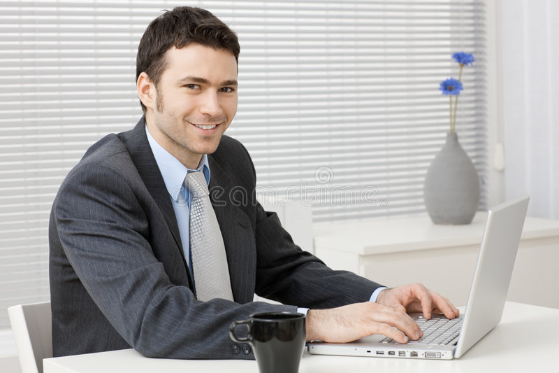 Businessman working on computer royalty free stock images