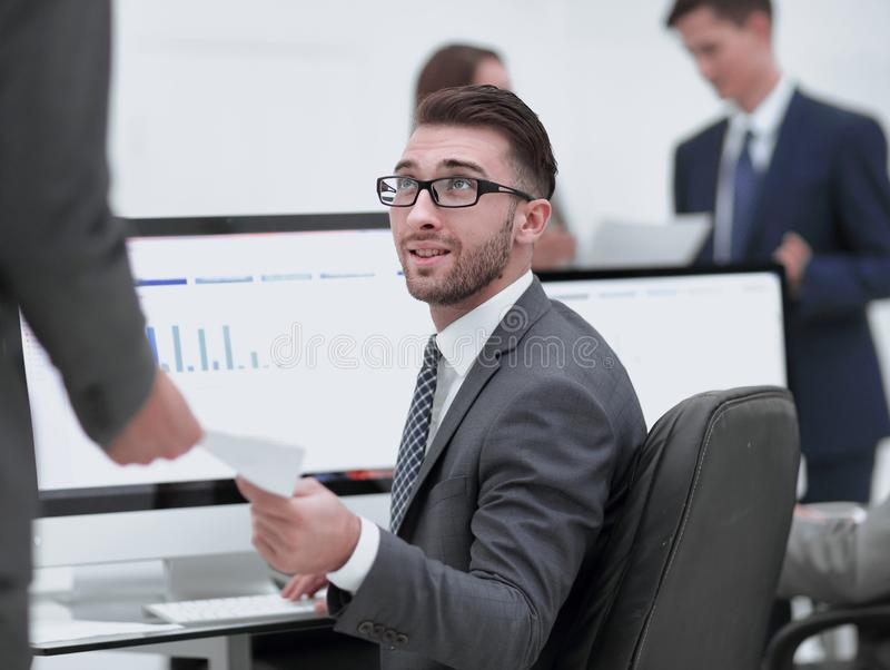 Businessman working on a computer on business reports stock photos