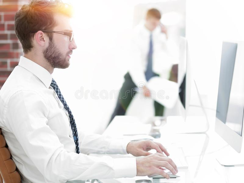 Businessman working on computer with financial charts stock photography