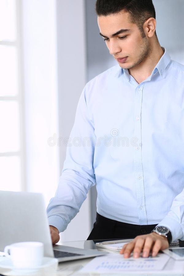 Businessman working with computer in modern office. Headshot of arab male entrepreneur or manager at workplace. Business. Concept royalty free stock image
