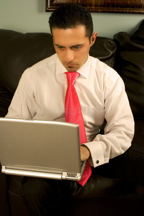 Businessman Working on the Couch royalty free stock photo