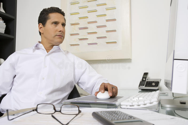Download Businessman Working At Desk Stock Image - Image: 29661163