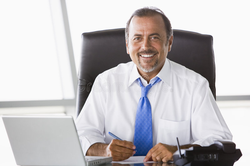 Businessman working at desk stock images