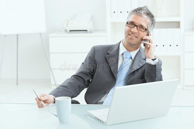 Businessman working at desk stock image