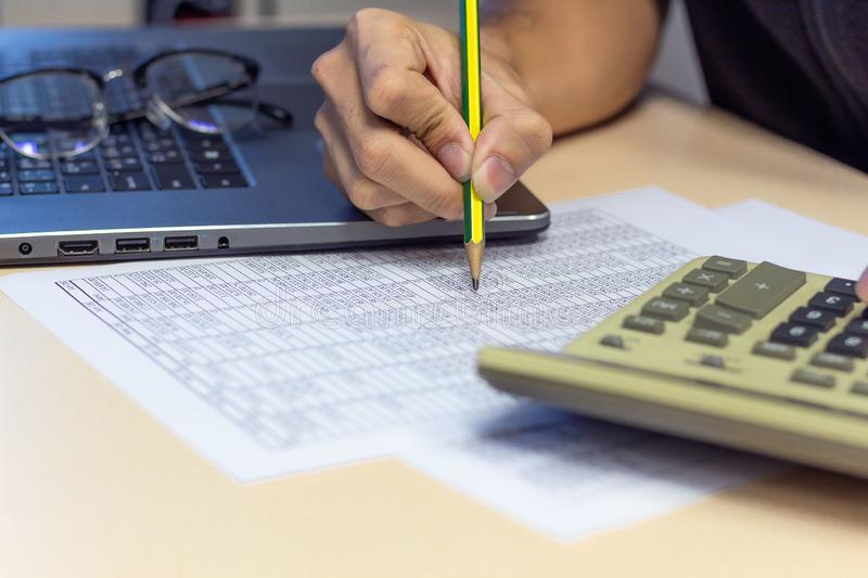 businessman working on desk office with using a calculator and pencil finance finance report stock photos