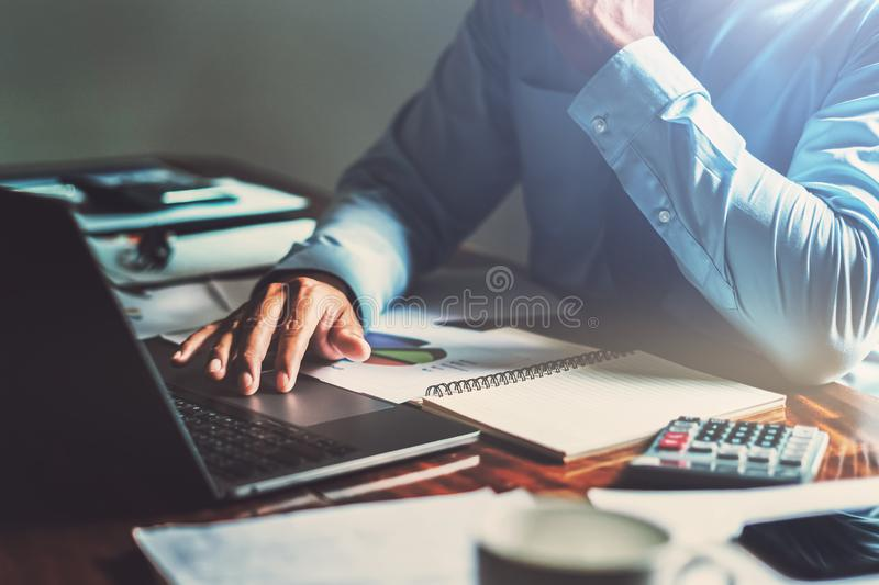 Businessman working on desk office with using computer laptop, finance accounting concept. Development, payment, workplace, strategy, trade, closeup, invest royalty free stock images