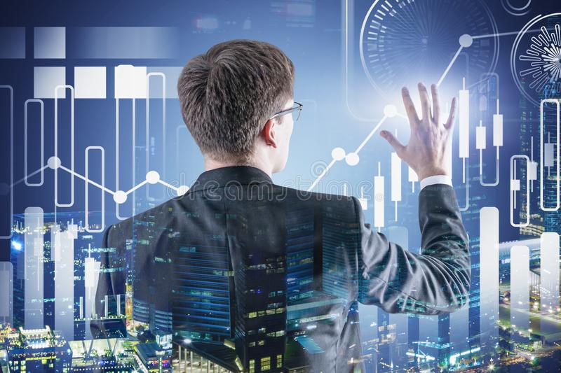Businessman working with digital graph in city stock image
