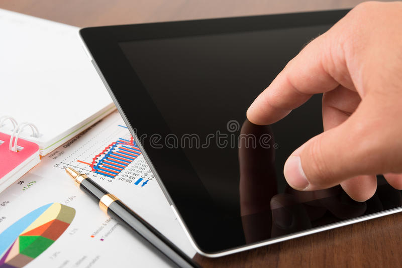 Download Businessman Working On A Digital Tablet Stock Photo - Image of electronic, computer: 26781736