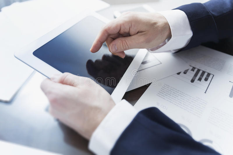Businessman working with digital tablet at office stock images