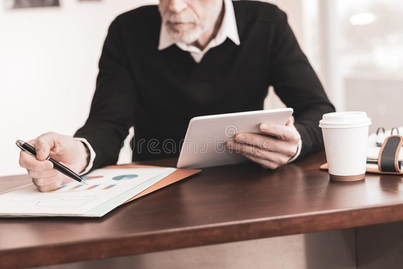 Businessman working on digital tablet at office royalty free stock photos