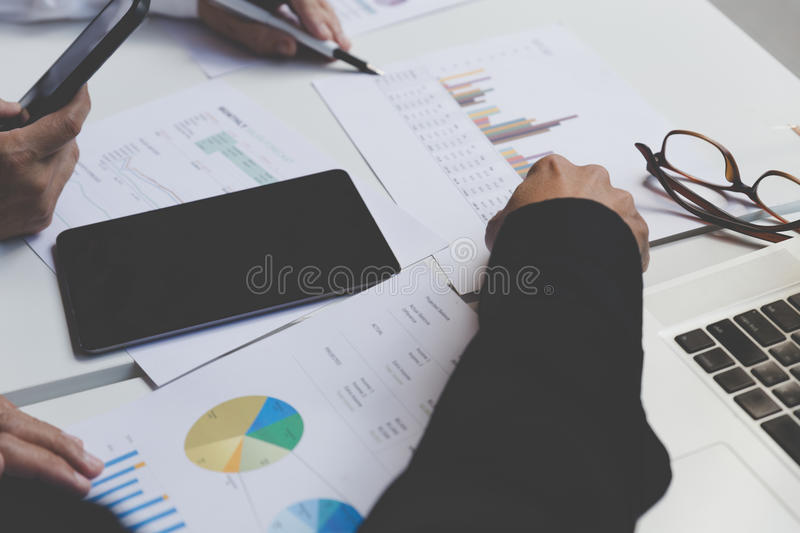 Businessman working with document, smartphone and digital tablet stock images