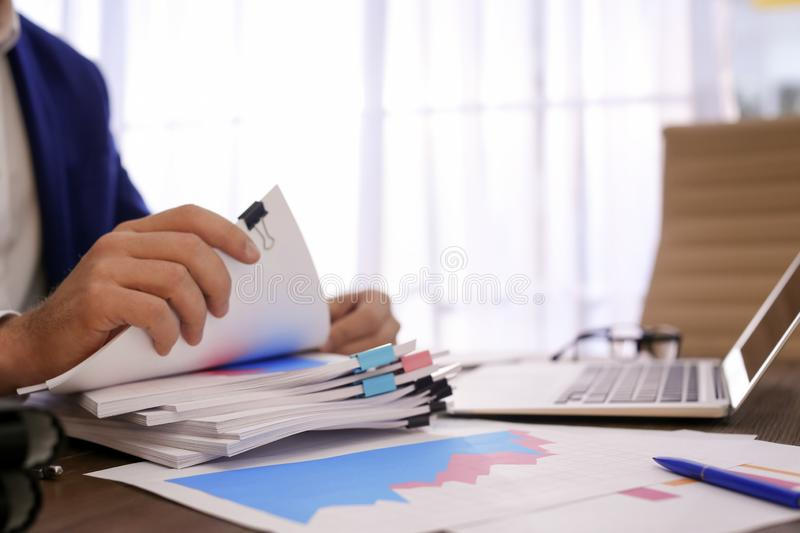 Businessman working with documents at office table, closeup. stock images