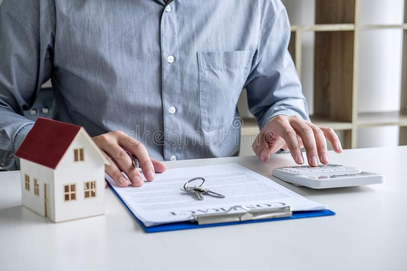 Businessman working doing finances and calculation cost of real estate investment while be signing to contract, Concept mortgage. Loan approval stock images