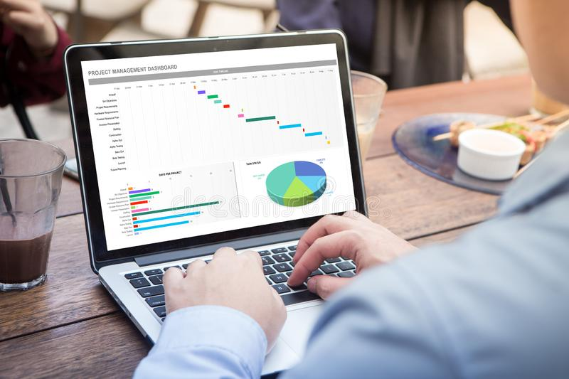 Businessman working with excel project dashboard using laptop / computer royalty free stock photos