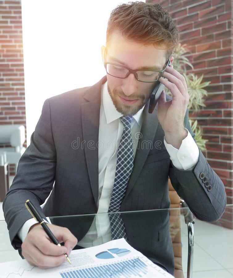 Businessman working with financial charts stock photos