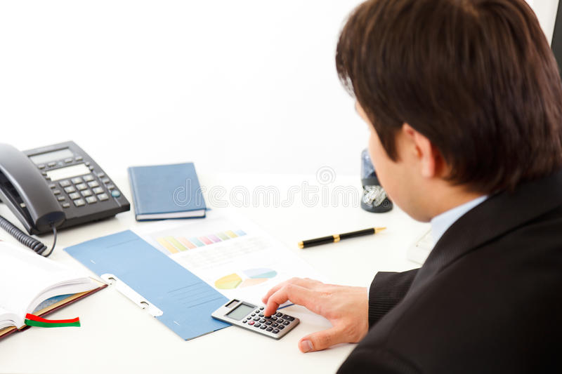 Businessman working with financial documents. royalty free stock image