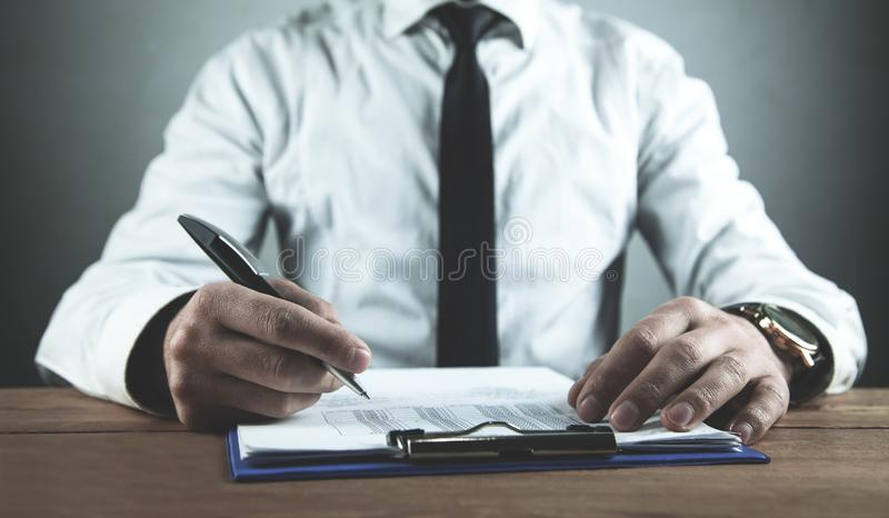 Businessman working with financial documents. Business concept stock photography