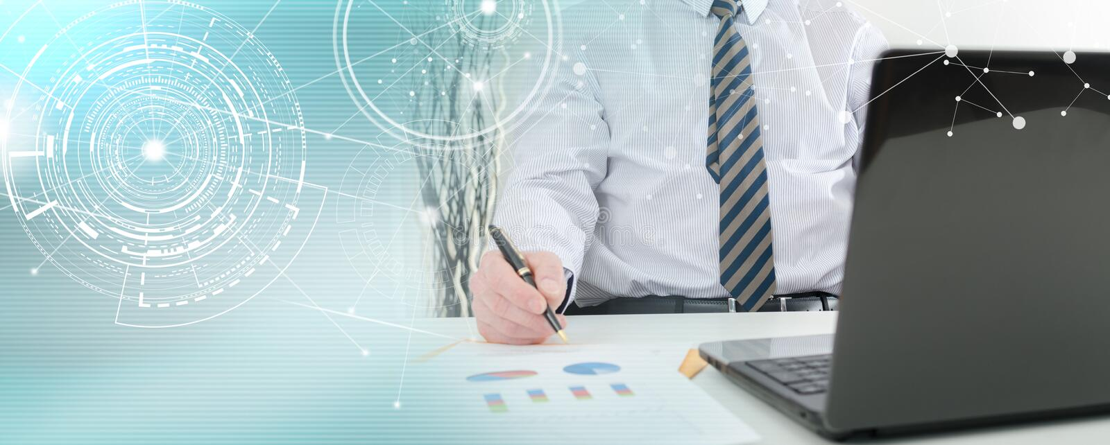 Businessman working on financial graphs; multiple exposure royalty free stock image