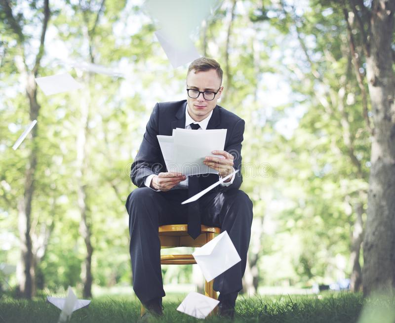 Businessman working in the forest stock photography