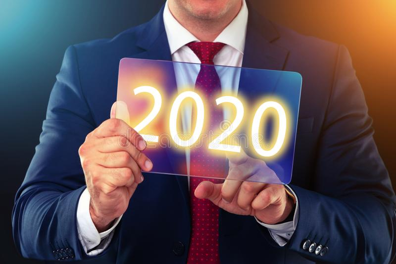 Businessman working with future technology screen, new year 2020 finance concept royalty free stock photography