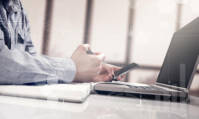 Businessman working generic design laptop. Touching screen smartphone. Worldwide connection technology interface. stock photos