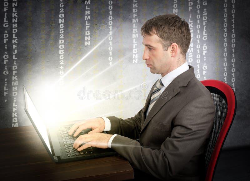 Businessman working on glowing laptop royalty free stock image