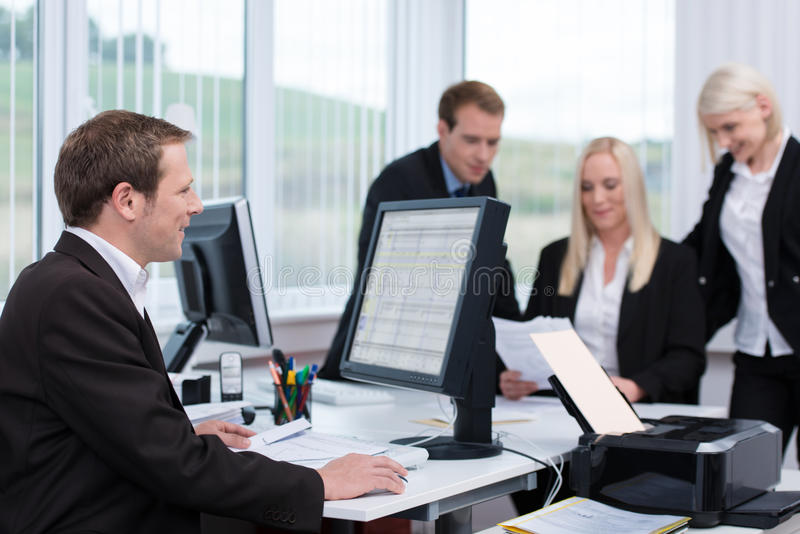 Businessman working at his desk on a desktop royalty free stock photo