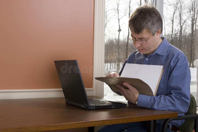 Businessman working from home stock photo