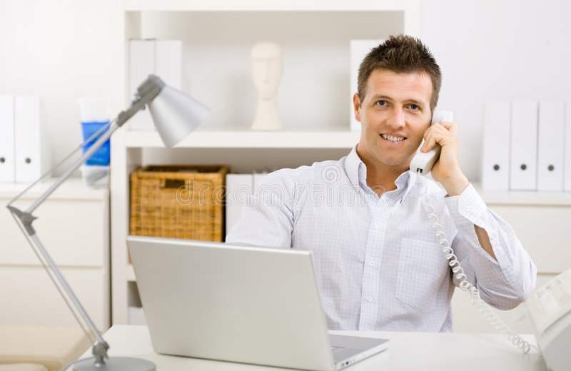 Businessman working at home stock image