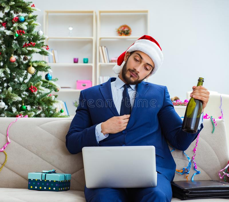 Businessman working at home during christmas. The businessman working at home during christmas stock photography