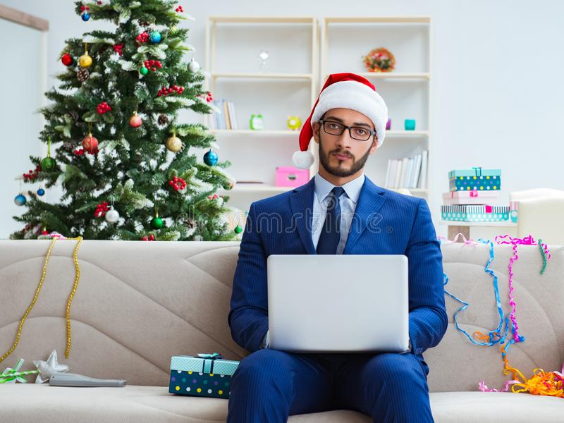 Businessman working at home during christmas royalty free stock photography