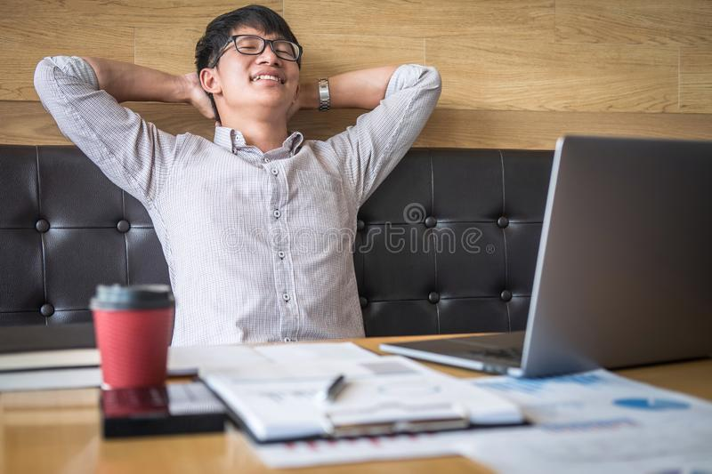 Businessman working investment project on laptop computer with report document and analyze, calculating financial data on graph. Documents, doing finance making stock images