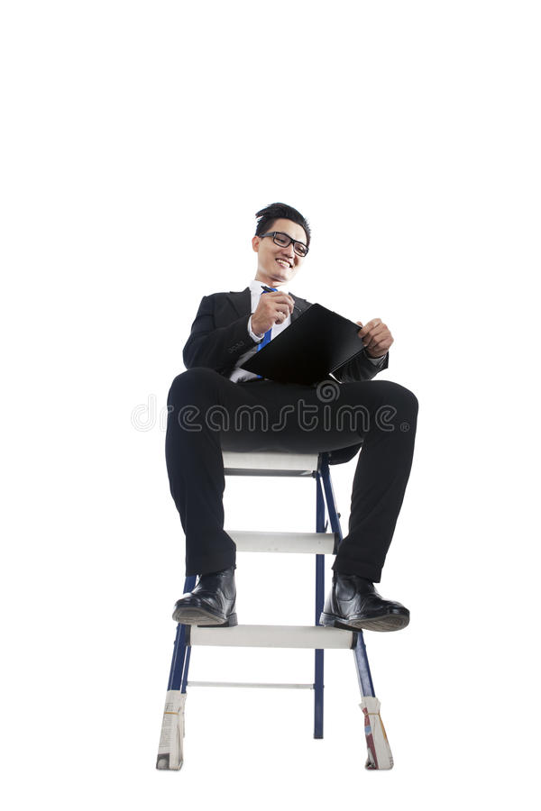 Businessman Working On Ladder Royalty Free Stock Photo