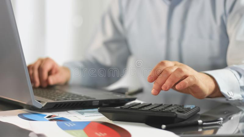 Businessman working laptop calculating data for tax report, company accountant. Stock photo stock image